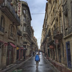 The Lonely Pilgrim. On the streets of old town Bordeaux after the break of the storm. Making our way down the southwest coast of France to Irun, Spain, the setting off point for the Norte Camino de Santiago.