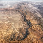 Up in the air, over the Al Hajar Mountains near Jabal Akhdar, Oman. I always enjoy those moments on a long-haul flight where I find myself astonished by a slice of landscape from above, and am again taken away in awe of our planet.  Taken on the Abu Dhabi