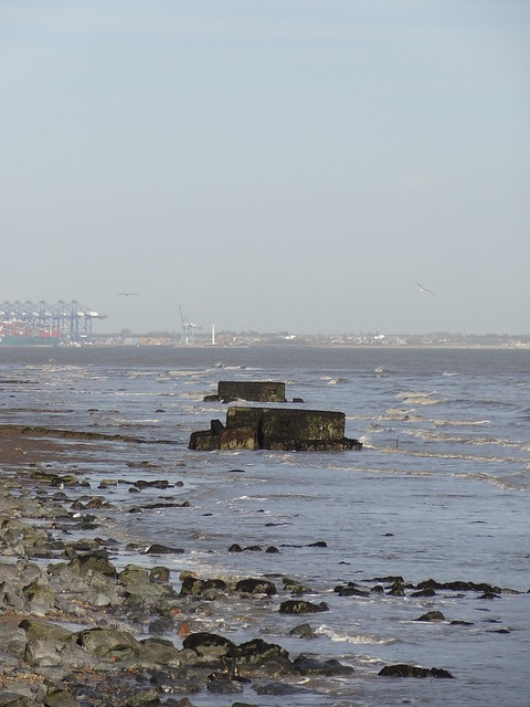 WWII pillboxes, fallen into the sea from the Naze