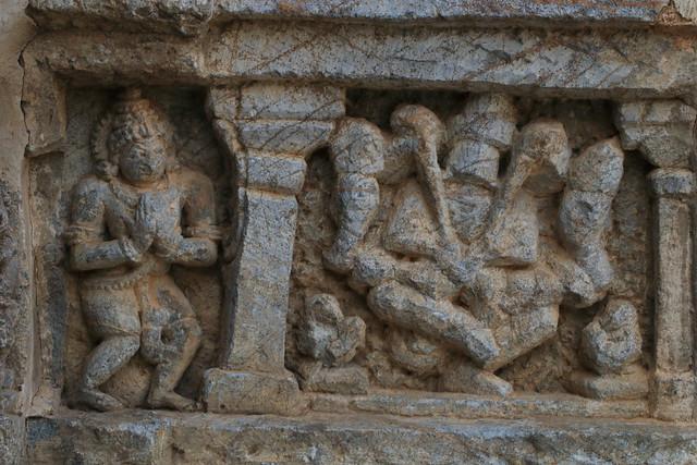 Narasimha killing Hiranyakashipu as Prahlada looks on