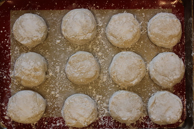 Dust your hands and dough well with tapioca or cornstarch and shape into rounds... think hockey pucks. =)