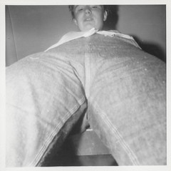 Looking up at a young woman's pants