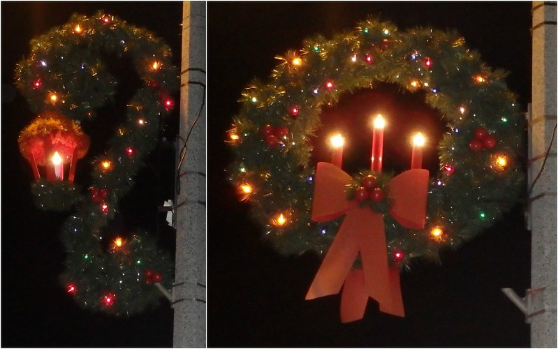 garland and an antique streetlight, and a wreath with three red candles