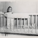 Small photo of Little African American boy in a crib