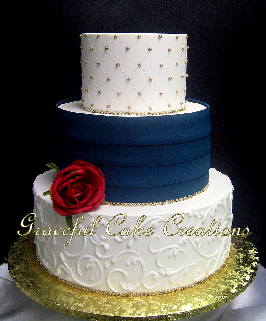 Elegant Ivory Butter Cream Wedding Cake With Navy Blue Pleats And Gold Sugar Pearls Bling