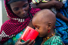 Asia Balaad, One and a half year old girl is fed by her mother - Momina Ali.