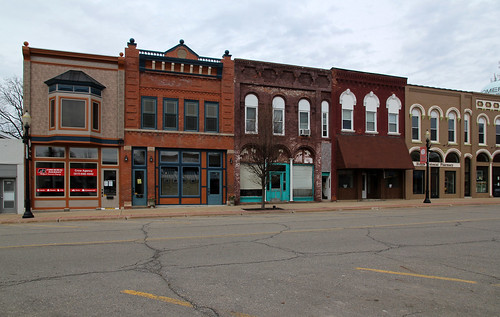 county street windows roof brick altered buildings bay calhoun michigan structures 11 historic sidewalk doorway commercial frame homer lamps storefronts twostory brackets pent transom cornices hoodmolds corbelled corbelling sidelights trabeated roundarched
