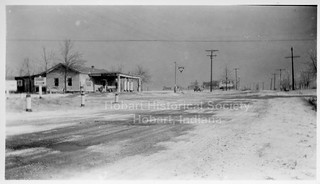 The Pantry, Tonagels' store on NE corner of 73rd & S.R. 51. Photographer is standing on 73rd, facing east toward S.R. 51. Posts marking cut-off joining 73rd and 51 visible at left. Undated.