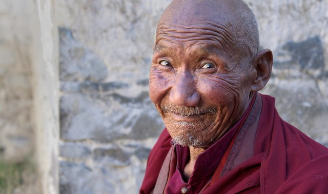 Monk of Tashi Lhunpo monastery make us laugh by pulling funny faces, Tibet 2015