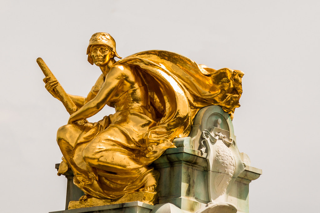 Gilded statue of Constancy by Aston Webb, in front of Buckingham Palace.