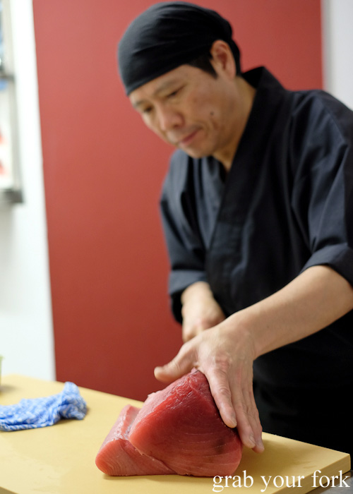 Chef Shinji Matsui slicing the tuna at Sashimi Shinsengumi, Crows Nest