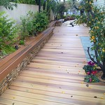 DuraLife Siesta decking in Golden Teak with Brazilian Cherry bench seating