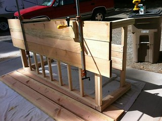 frame of table put together and screwing table top boards down
