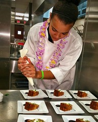 Longview High School junior Kayla Jackson prepares some 'Hawaiian Wedding Cake' for the LISD Education Foundation luncheon, hosted by the Culinary Arts department.