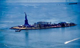 Image of Statue of Liberty near City of Jersey City. thestatueoflibertyus thestatueoflibertyinnewyorkharborny newyorkharborny
