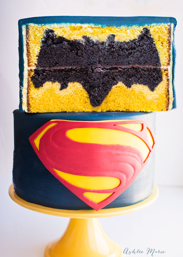 video tutorial for this batman vs superman cake - a simple classic superman cake with a surprise batman logo inside