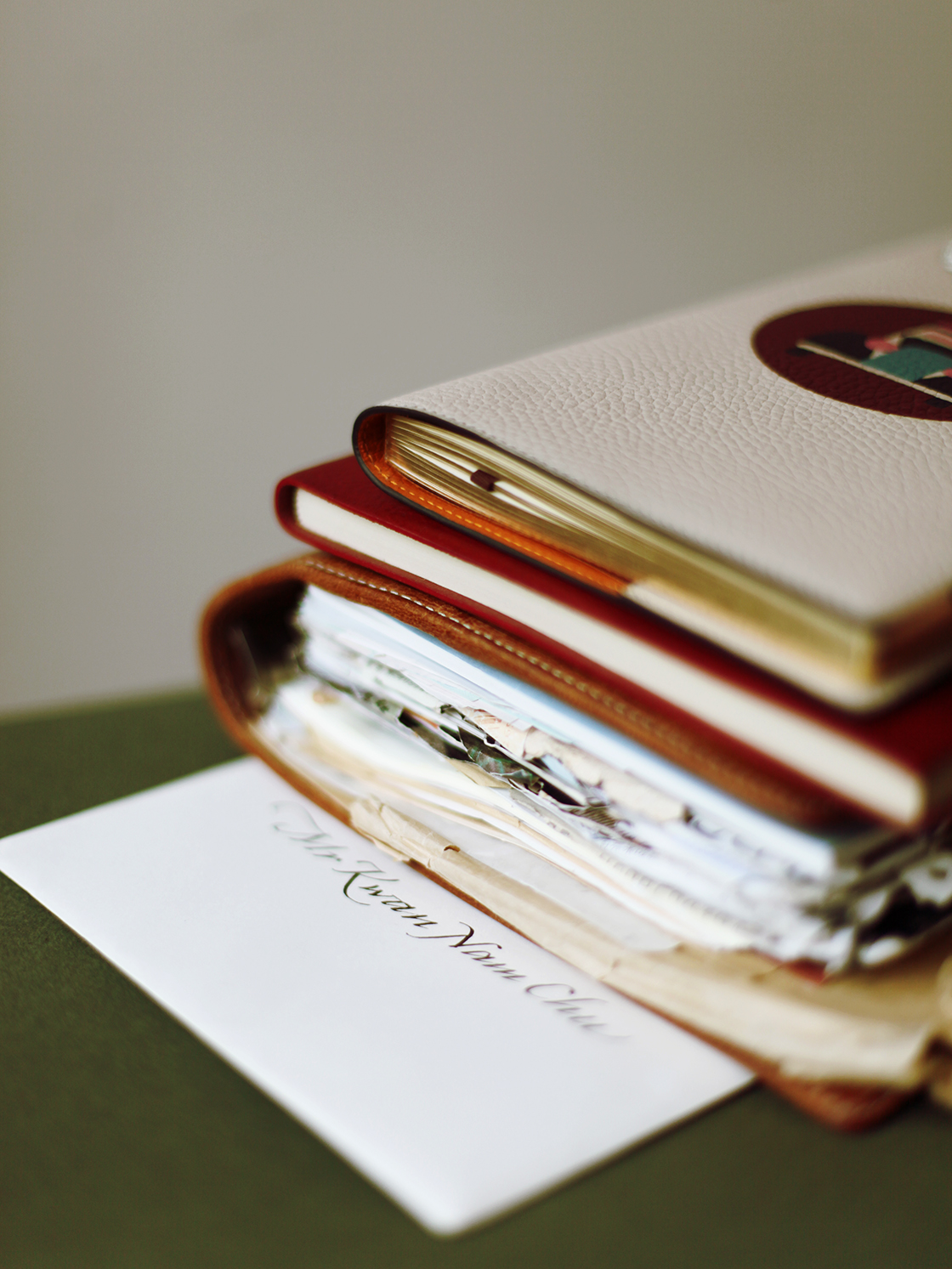 a stack of leather notebooks 2