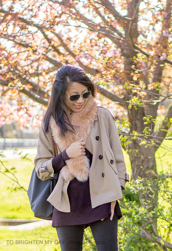 faux fur scarf, camel trench cape, plum tunic sweater, black skinny jeans