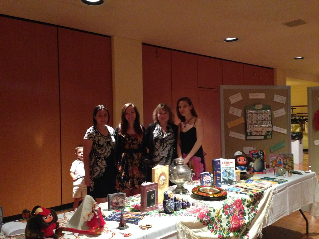 Tatyana Bystrova (second from right) with instructors in the foreign language academy and a table of Russian books and cultural items.