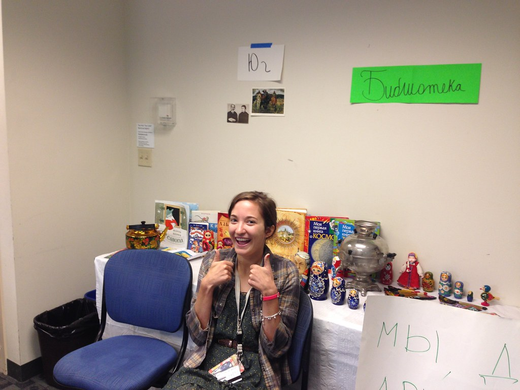 Student assistant for the Russian foreign language academy with Russian nesting dolls and other Russian cultural items.