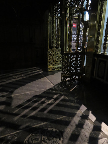 Sunlight streaming in through the brass doors of the Nieuwe Kerk (New Church) in Amsterdam, Holland