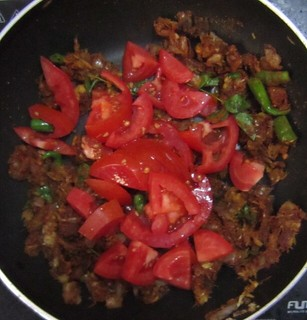 Chicken biriyani steps 9 Add tomato