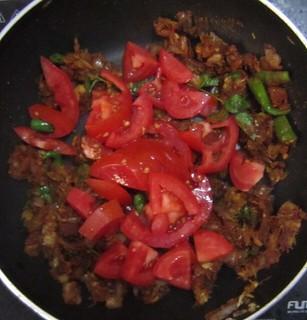 Chicken biriyani steps 9 Add tomato