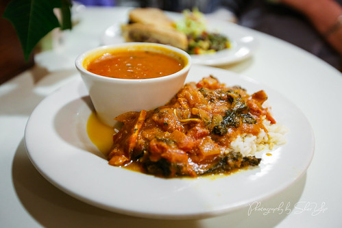 Chicken Moambe - Traditional Congo dish with tomatoes, garlic, onions, greens, almond butter, and ginger - Phipps Conservatory