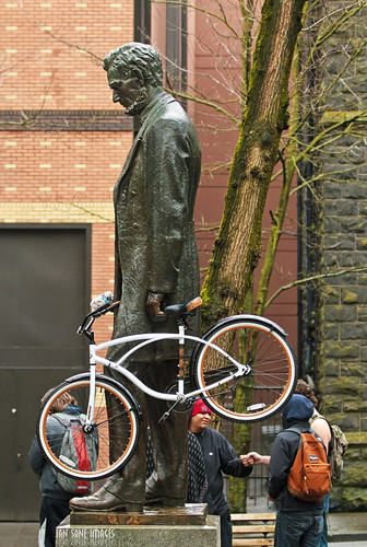 park street camera sculpture southwest men bicycle oregon canon portland lens ian photography eos is downtown hand candid president images abraham fist 7d lincoln usm avenue bump sane huffy ef100400mm f4556l thepresidentialhuffpost
