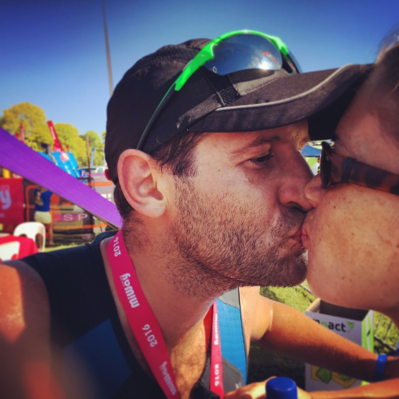 A nice kiss for a nice medal