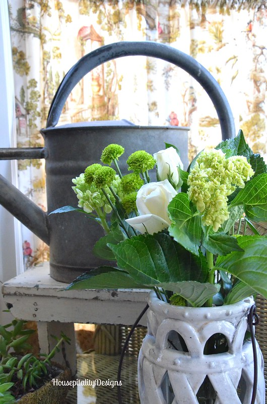 Vintage Watering Can with lantern filled with flowers - Housepitality Designs