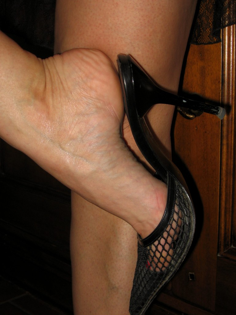 image Dangling black patent heels and stockings 2