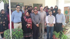 Mr. Carsten Mueller and Wajid Junejo photographed with staff of Sahara Welfare Society being run by Engro at Daharki