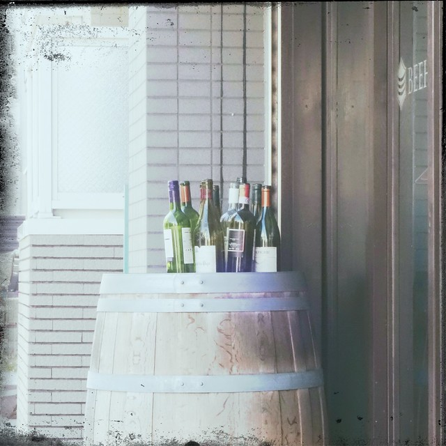 Bottles_on_top_of_wine_barrel