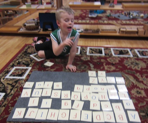 singing the alphabet to match the letters