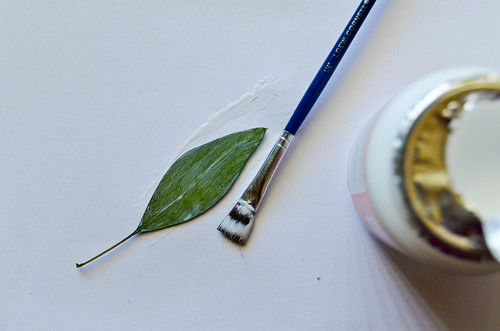"5. Paint the ""good side"" of the leaves with Mod Podge"