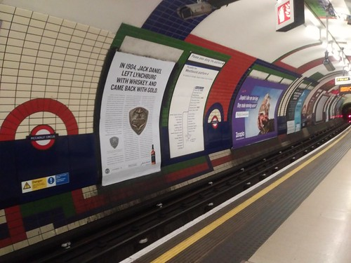 Advertisements on the wall in the Piccadilly Circus Station, London Underground