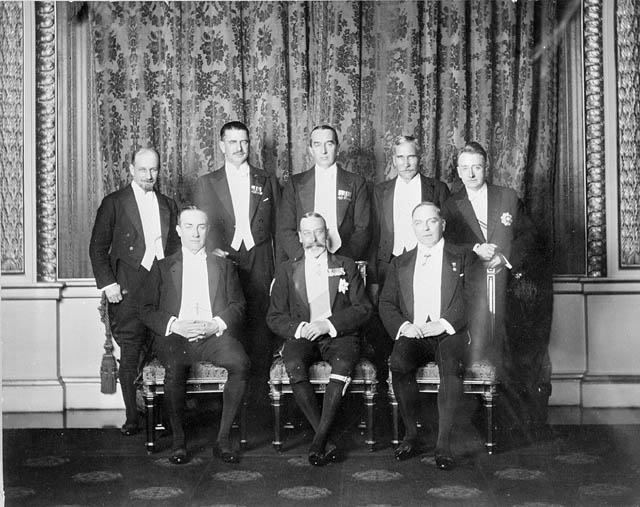 George V and his Prime Ministers at the 1926 Imperial Conference. The conference was the sixth Imperial Conference held amongst the Prime Ministers of the dominions of the British Empire. It was held in London from October 19 to November 22, 1926. It was notable as the conference that produced the Balfour Declaration, which established the principle that the dominions are all equal in status, and not subordinate to the United Kingdom. George V (seated, centre) with Rt. Hon. Stanley Baldwin (seated left), Rt. Hon. W.L. Mackenzie King (seated, right). Standing Rt. Hon. Walter Stanley Monroe, Rt. Hon. Gordon Coates, Rt. Hon. Stanley Bruce, Rt. Hon. J. B. M. Hertzog and W.T. Cosgrave. Photo taken on November 4, 1926.