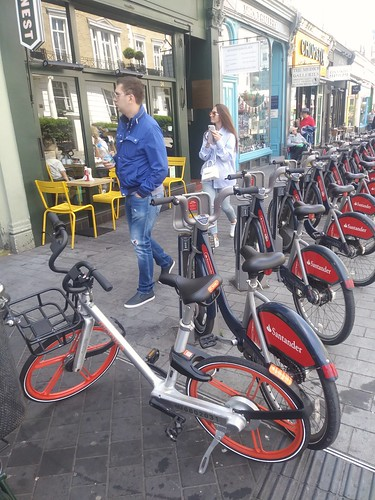 Santander bike share station near the South Kensington London Underground station, with a dockless bike