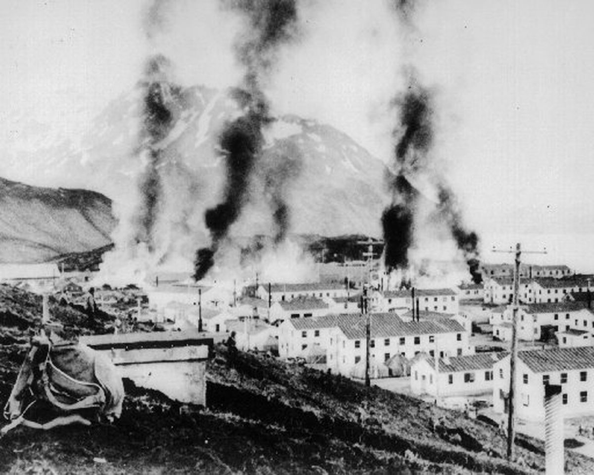 Buildings burning after the first Japanese attack on Dutch Harbor, Alaska on June 3, 1942.