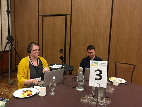 Caroline & Brian doing soundcheck for a live podcast at the Canadian Evaluation Society 2018 conference