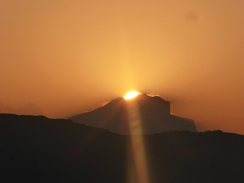 The sun rising over an Annapurna Mountain at sunrise as seen from Poon Hill in Nepal