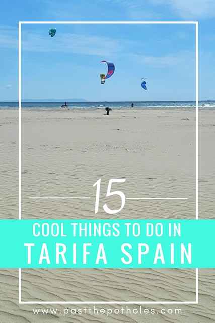 White sand beach with kitesurfer and the text: 15 cool things to do in Tarifa