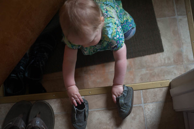 Lady Jr Grabbing Shoes