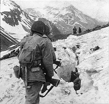 U.S. troops navigate snow and ice during the Battle of Attu, Alaska, in May 1943. Their vehicles could not move across the island's rugged terrain.