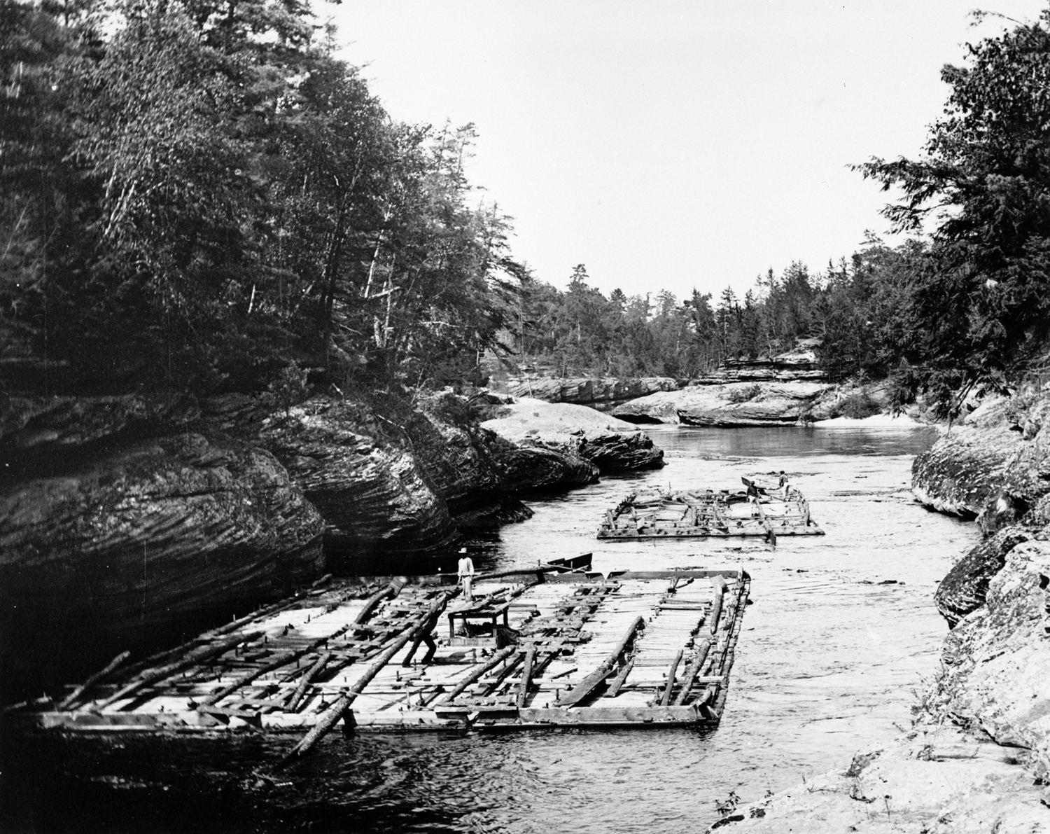 Lumber rafts on the Wisconsin River near the Wisconsin Dells, circa 1886. Photograph by H.H. Bennett, courtesy of the Wisconsin Historical Society, Image ID 6314.