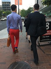 Red and blue outfit, young men walking on 19th Street NW, Washington, D.C.