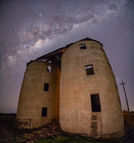 Abanonded silos under an abundant sky