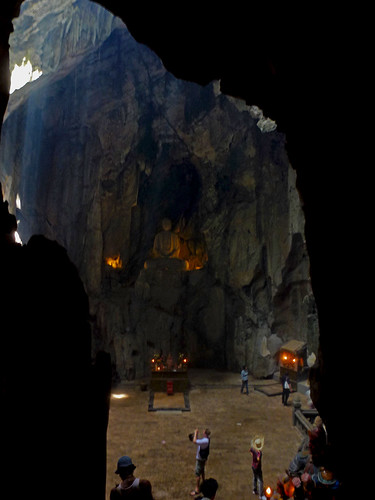 A Cave containing a large curved Buddha  near the ancient city of Hue.