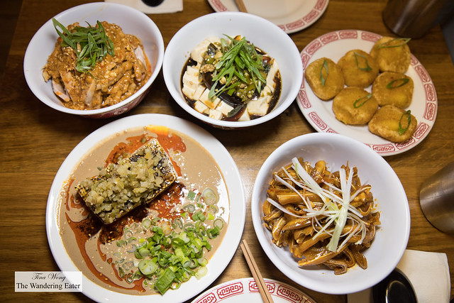 Spread of small plates (top left, clockwise) - Mouthwatering Chicken Thigh (口水鸡), Naughty Tofu, Sweet Pumpkin Rice Cake, Braised Pork Ear Slices in Chili Oil, Sesame Tofu